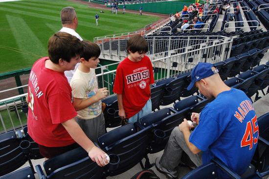 6_zack_signing_baseballs.jpg
