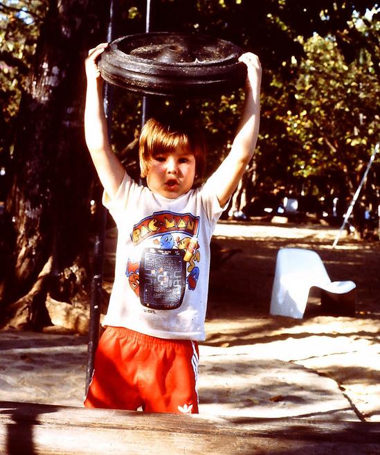 zack_lifting_metal_wheel.JPG
