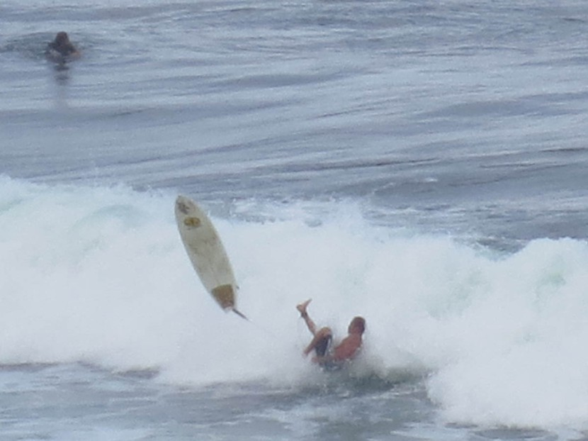 515_surfer_wiping_out