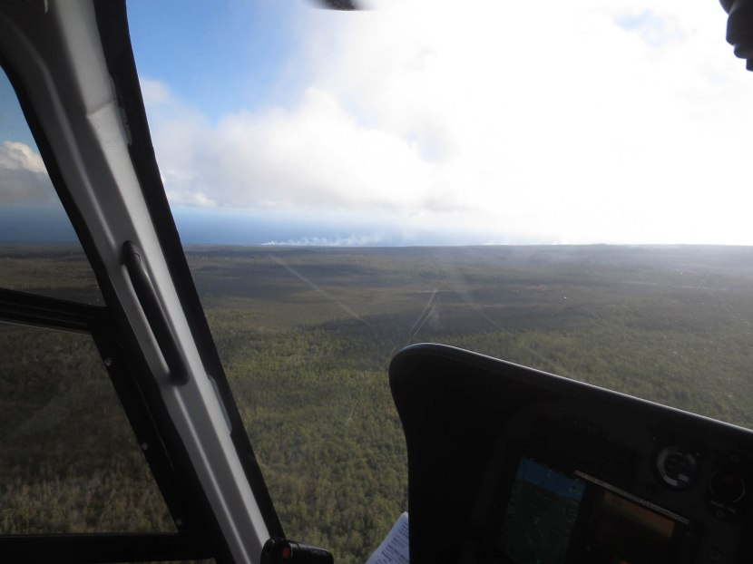 561_flying_over_rain_forest_with_smoking_lava_in_the_distance