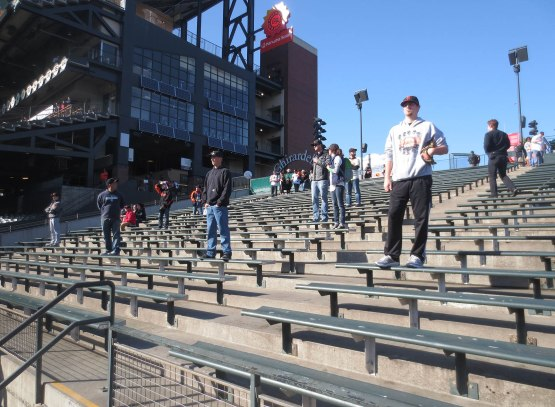 12_fans_standing_on_bleachers