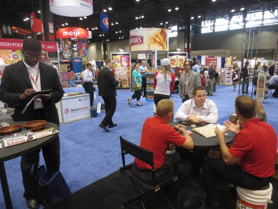 14_business_meeting_at_the_bigs_booth