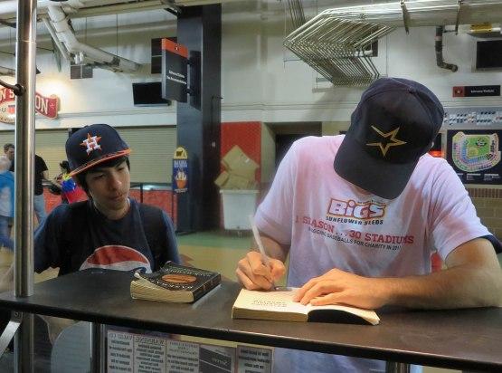 17_zack_signing_watching_baseball_smarter_05_04_13