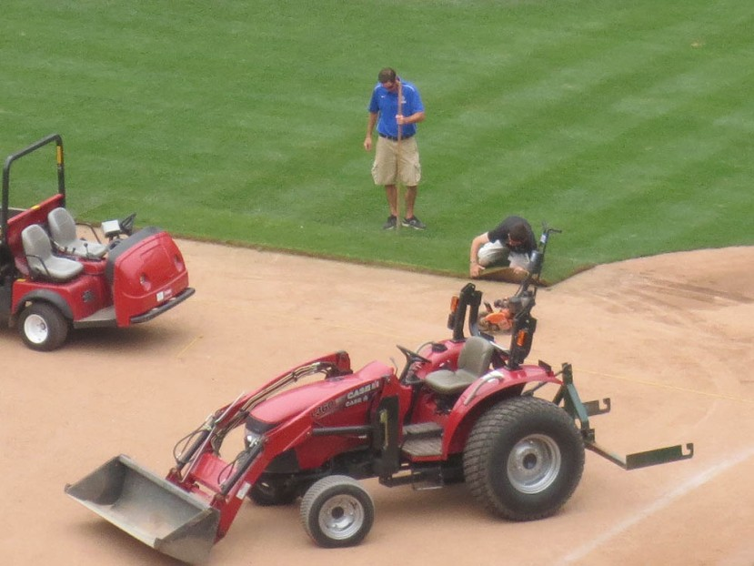 27_grounds_crew_laying_down_sod