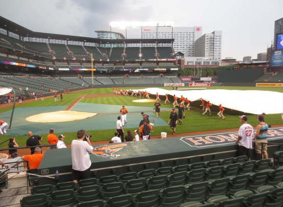 4_grounds_crew_pulling_out_the_tarp_06_26_13