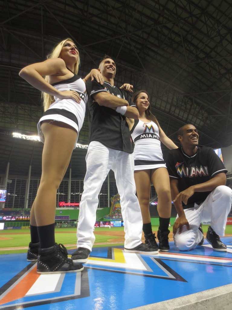 27_dancers_posing_atop_dugout_roof