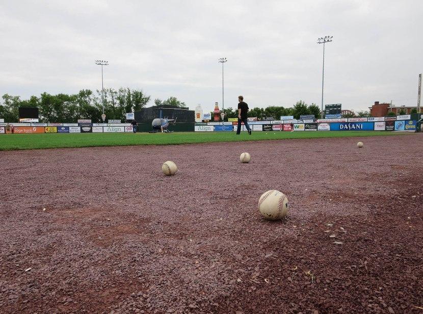 57_hd_baseballs_on_warning_track