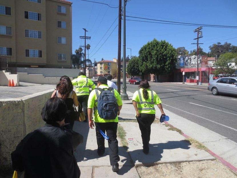 11_employees_walking_to_stadium