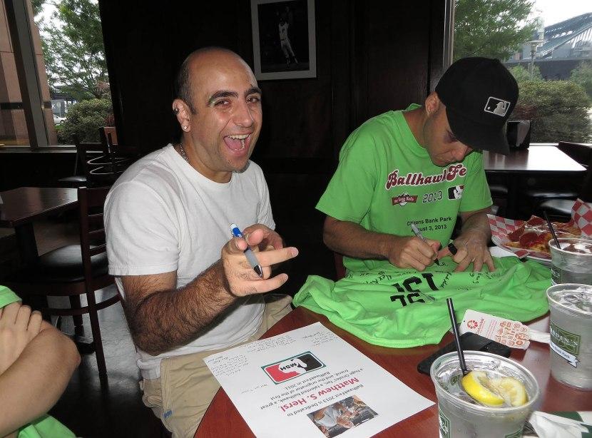 11_zack_signing_shirt_for_matt_hersl