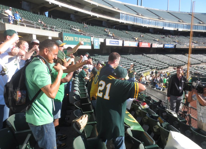 14_fans_in_bleachers_being_filmed