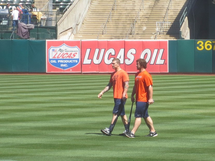 4_astros_players_walking_across_field
