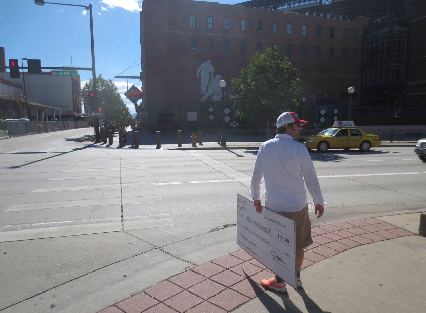 18_neal_with_big_check_outside_coors_field
