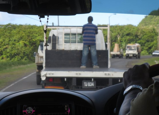 143_man_riding_on_truck