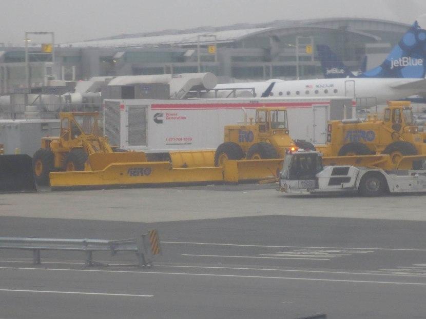 9_huge_snow_plows_ready_on_runway