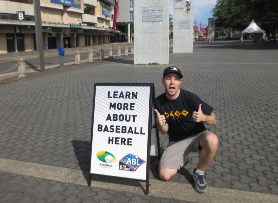 21_zack_posing_with_baseball_sign