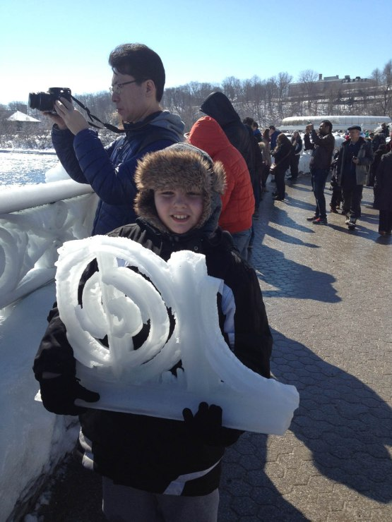 71_kid_with_ice_from_railing