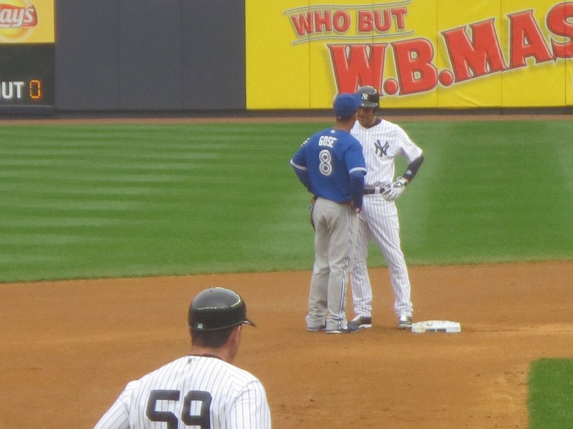 42_anthony_gose_greeting_derek_jeter_at_second_base_during_a_pitching_change
