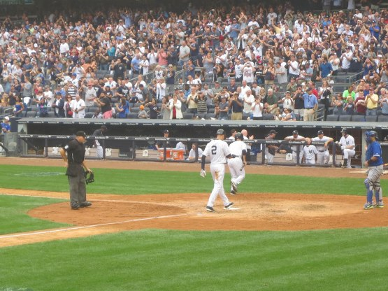 48_derek_jeter_scoring_on_the_second_homer_of_the_game_by_brian_mccann