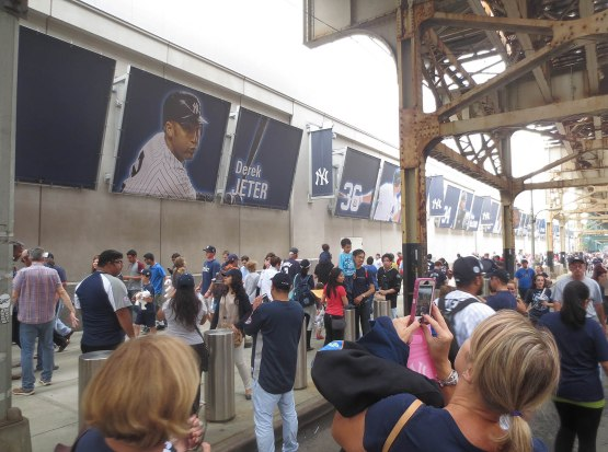 52_fans_worshipping_derek_jeter_shrine_outside_the_stadium
