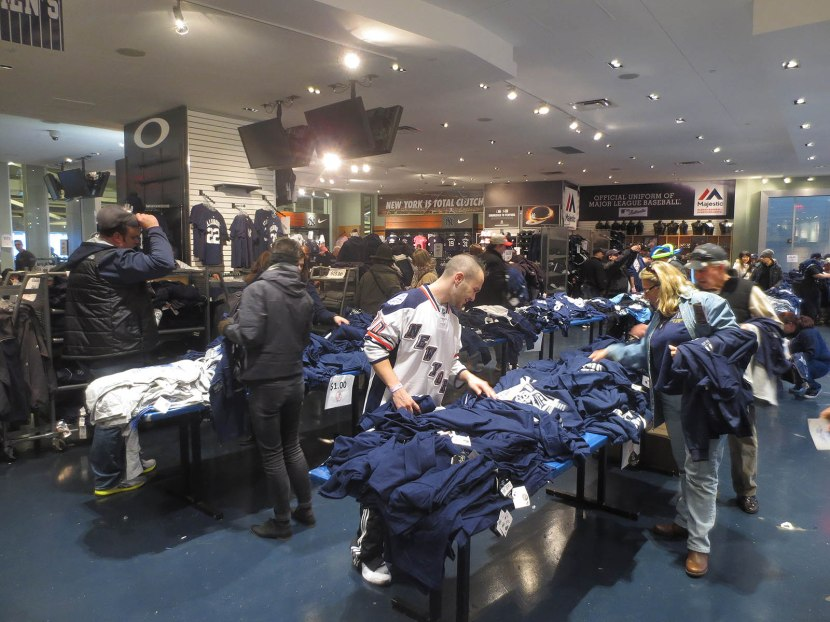 46_chris_browsing_one_dollar_shirts_in_the_team_store