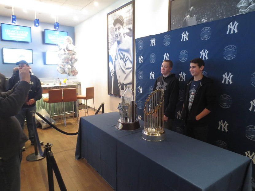 8_kids_posing_with_world_series_trophy