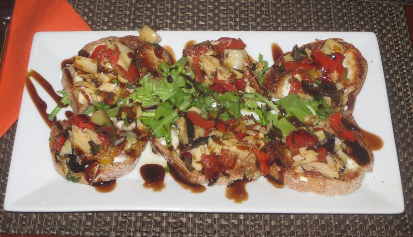 278_toasted_bread_topped_with_goat_cheese_fresh_roasted_pepper_olives_and_artichoke_hearts_with_balsamic_vinaigrette
