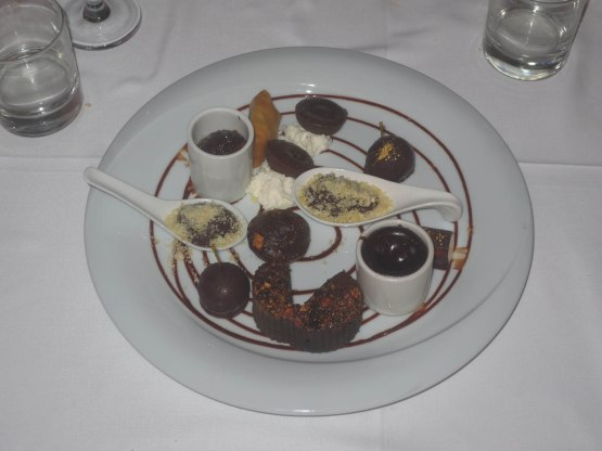 357_chocolate_sampler_plate_for_dessert_including_frozen_lychees_coated_with_chocolate_and_mousse_with_a_coating_of_pop_rocks