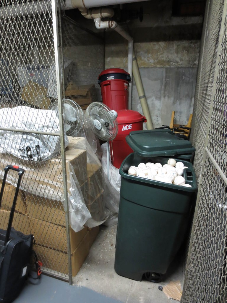 1_barrels_of_baseballs_in_the_basement
