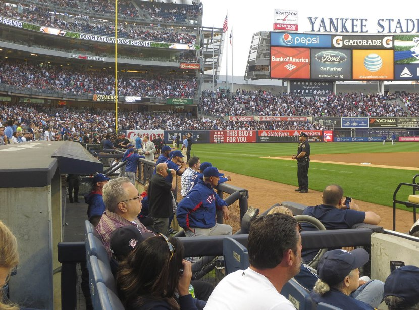 15_rangers_watching_from_their_dugout