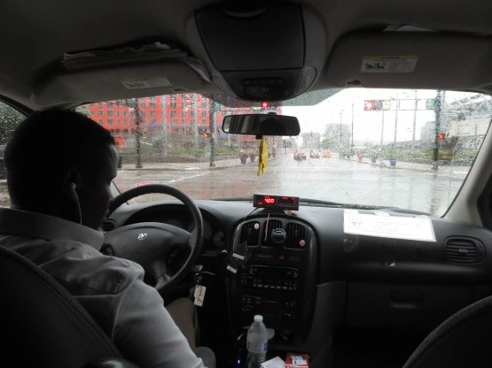 17_taxi_in_the_rain_to_the_stadium