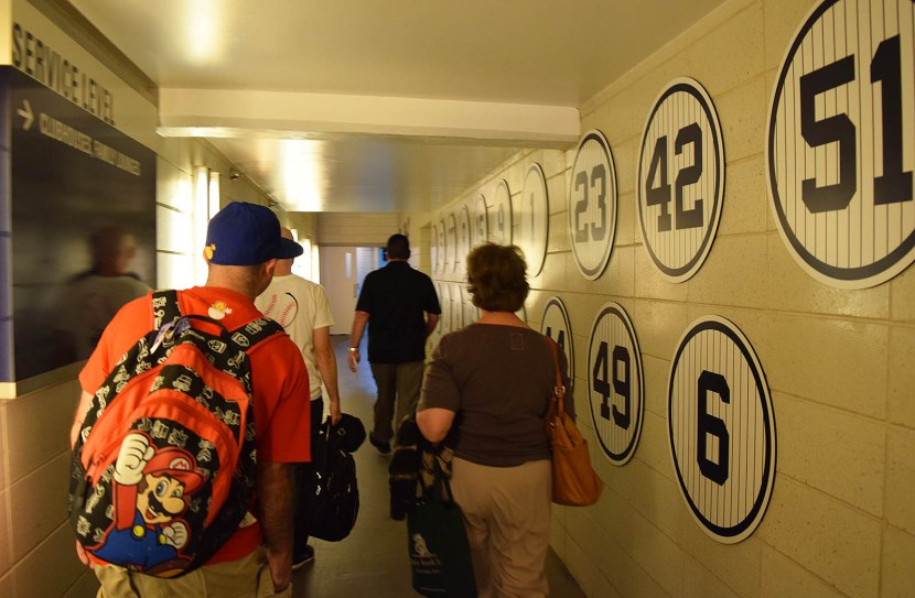 18_walking_through_a_hallway_with_retired_numbers