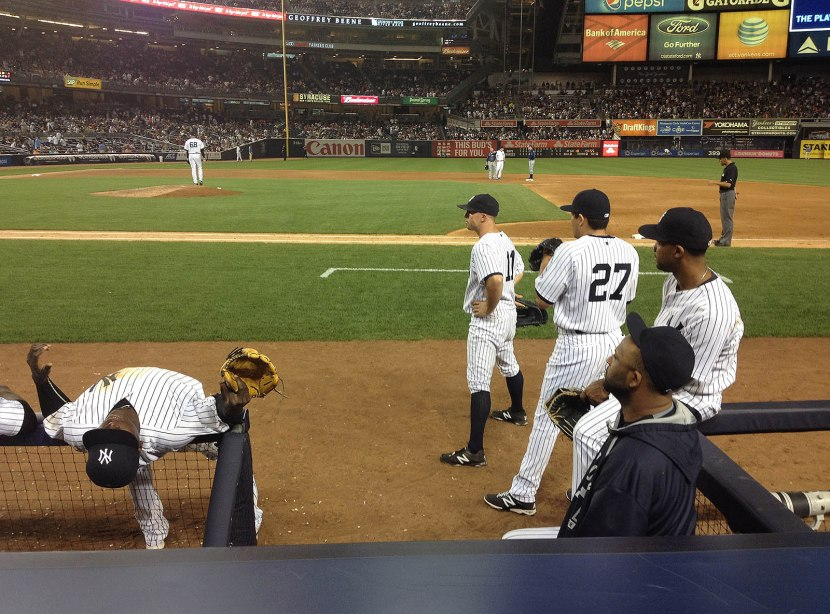 75_didi_gregorius_stretching_on_the_dugout_railing_durintg_a_replay_review