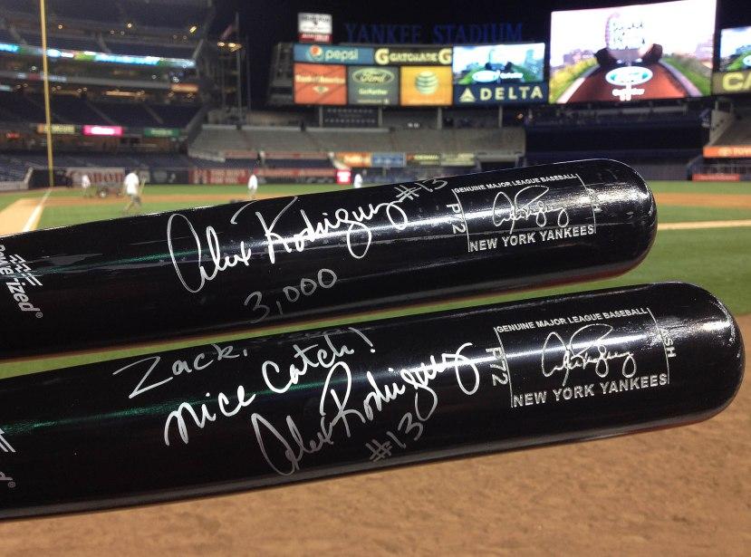 87_autographed_bats_closeup