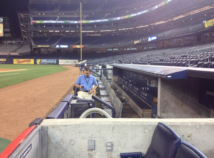 89_security_guard_in_empty_dugout