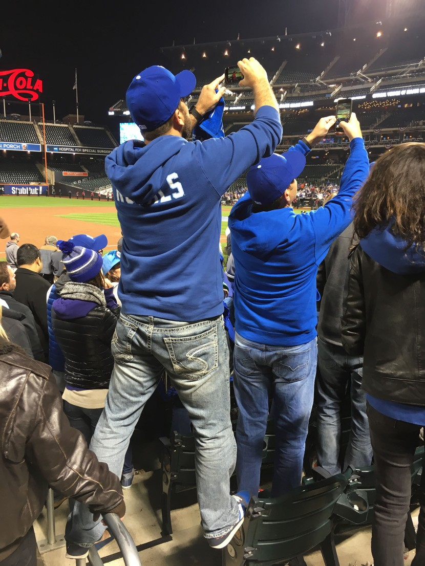 35_fans_standing_on_seats