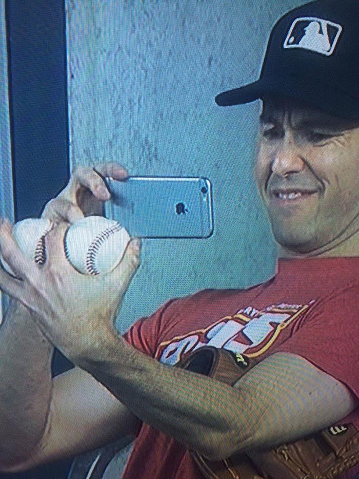 16_zack_photographing_baseballs