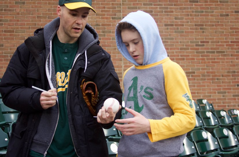 22_zack_signing_a_baseball_for_zach