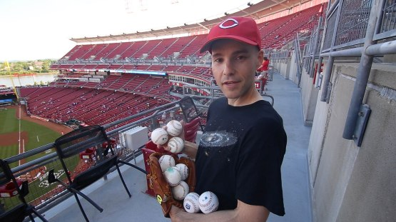 27_zack_with_baseballs_in_upper_deck
