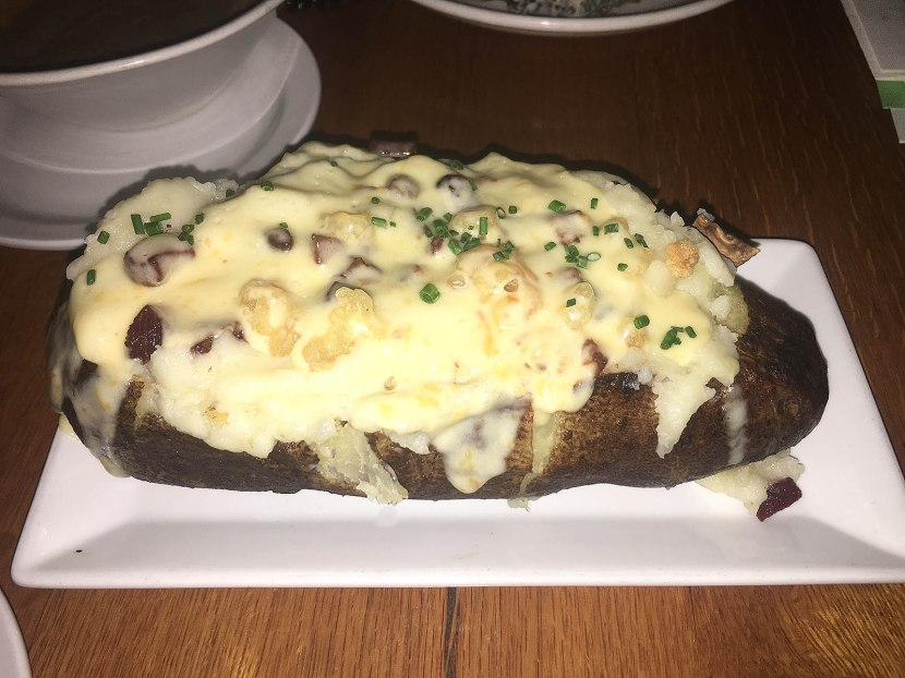 31_baked_potato_loaded_with_a_whole_lot_of_stuff