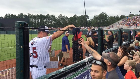 29_roger_mcdowell_handing_out_braves_caps