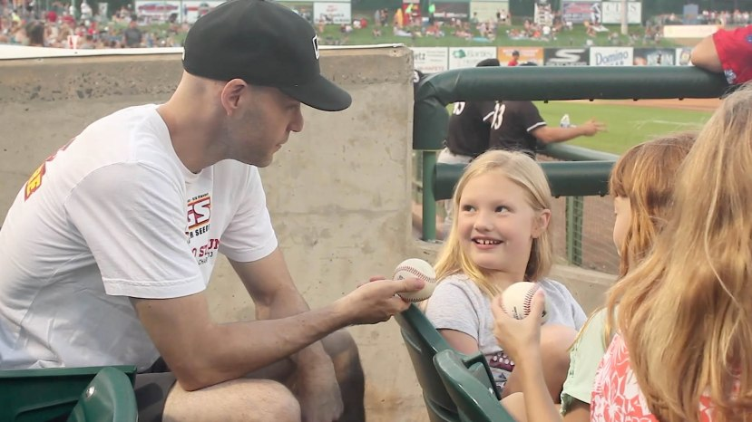 22_zack_giving_baseballs_to_kids