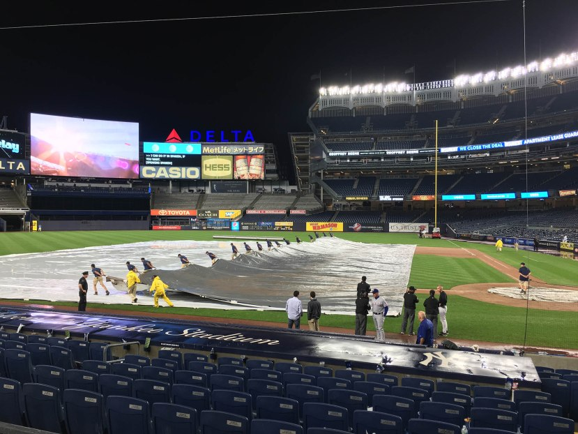 23_grounds_crew_removing_the_tarp_06_27_16
