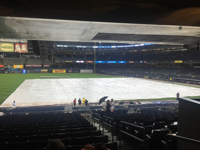 7_tarp_covering_the_infield