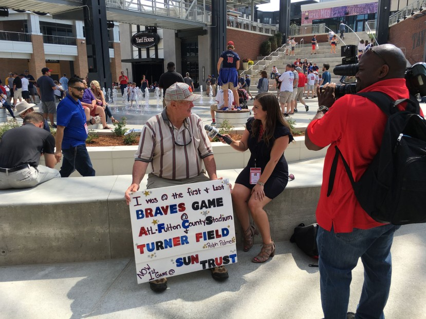 10_old_fan_with_stadium_sign.JPG